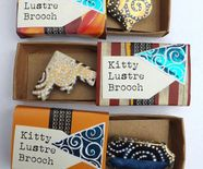 vintage upcycled tiles into kitty brooches